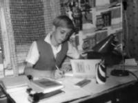 Актёр Коля Бурляев дома делает уроки. Россия. 1961 – 1962 гг. Фот. О.А. Мерцедин